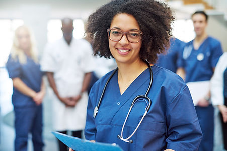 pretty-black-doctor-standing-in-the-clin