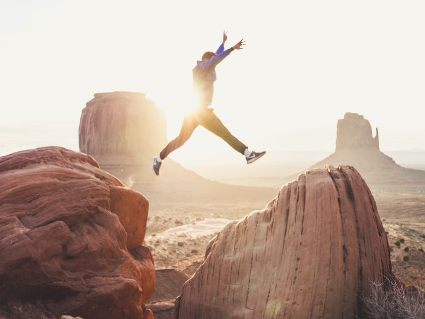 Man jumping between 2 rocks