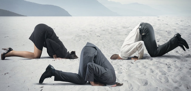 business people with heads-in-the-sand.jpg