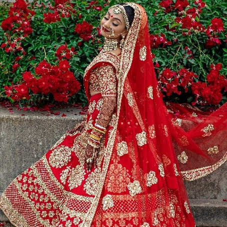 Why Do South Asian Brides Wear Red On Their Wedding Day?