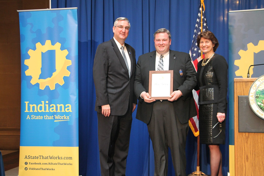 Pictured from left to right are Governor Eric Holcomb, Rob Blackburn, and Elaine Bedel (Indiana Economic Development Corporation - President).  This photo was taken on March 27, 2017 in the Indiana Statehouse where Professional Glass Co., Inc. received the State of Indiana Governor's Half Century Award.
