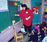 Raenell at Highland Elementary 3rd Grade Class 1996 teaching them about Leap Day.