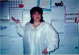 Raenell in Front Of 35 February 1996 Calendars that do not have the words LEAP DAY on the 29th.