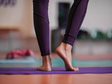 woman standing at yoga class.jpg