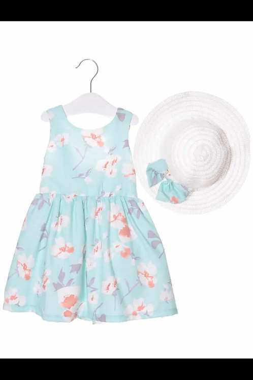 Mint green dress and straw hat
