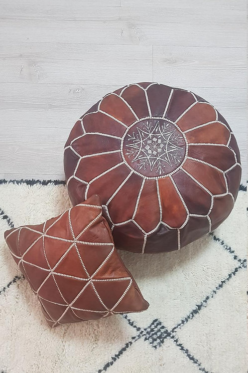 COLLECTION OF 1 LUXURY LEATHER POUF TAN & 2 LEATHER SQUARE EMBROIDERED PILLOWS