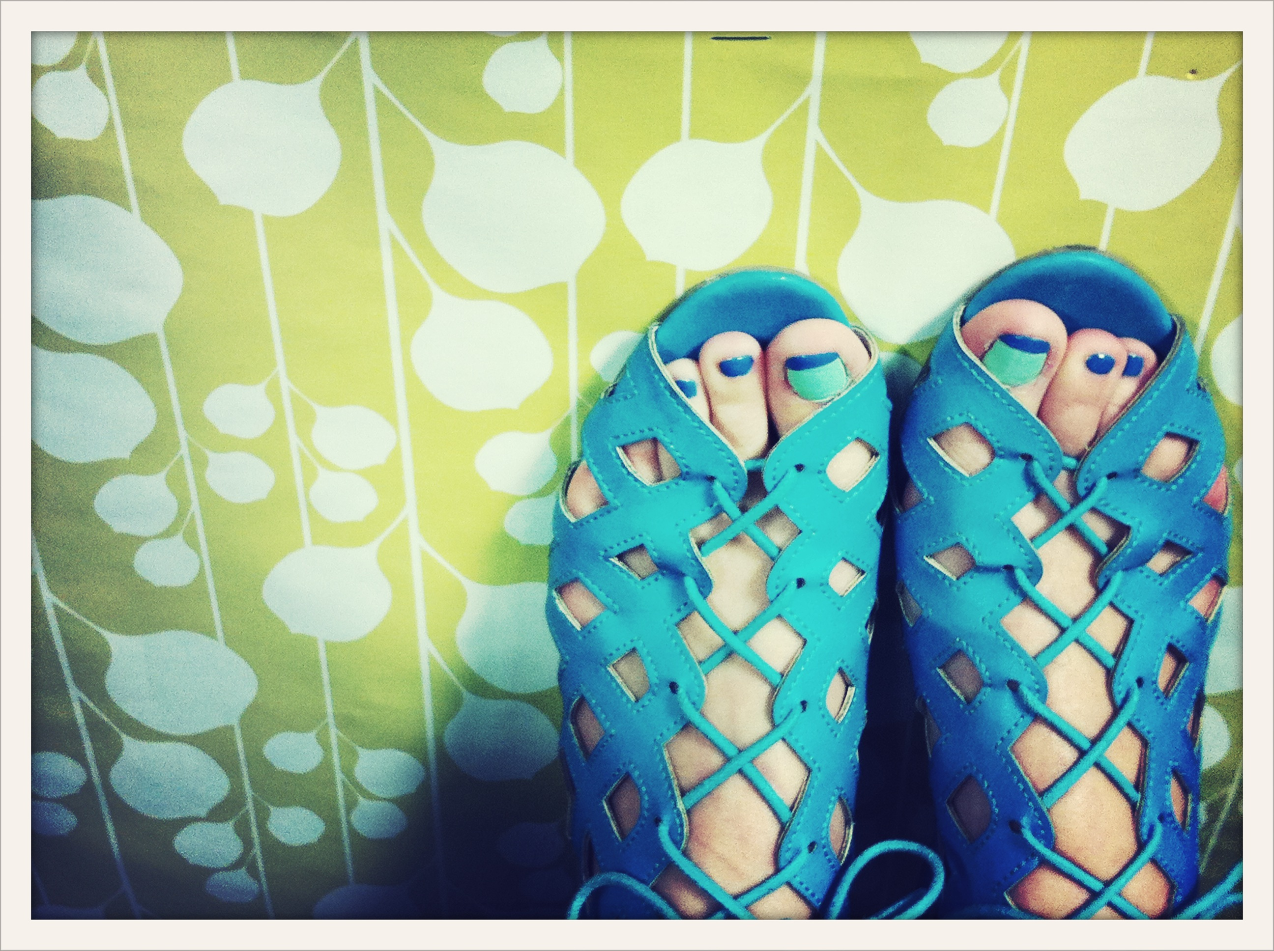 turquoise sandals on yellow