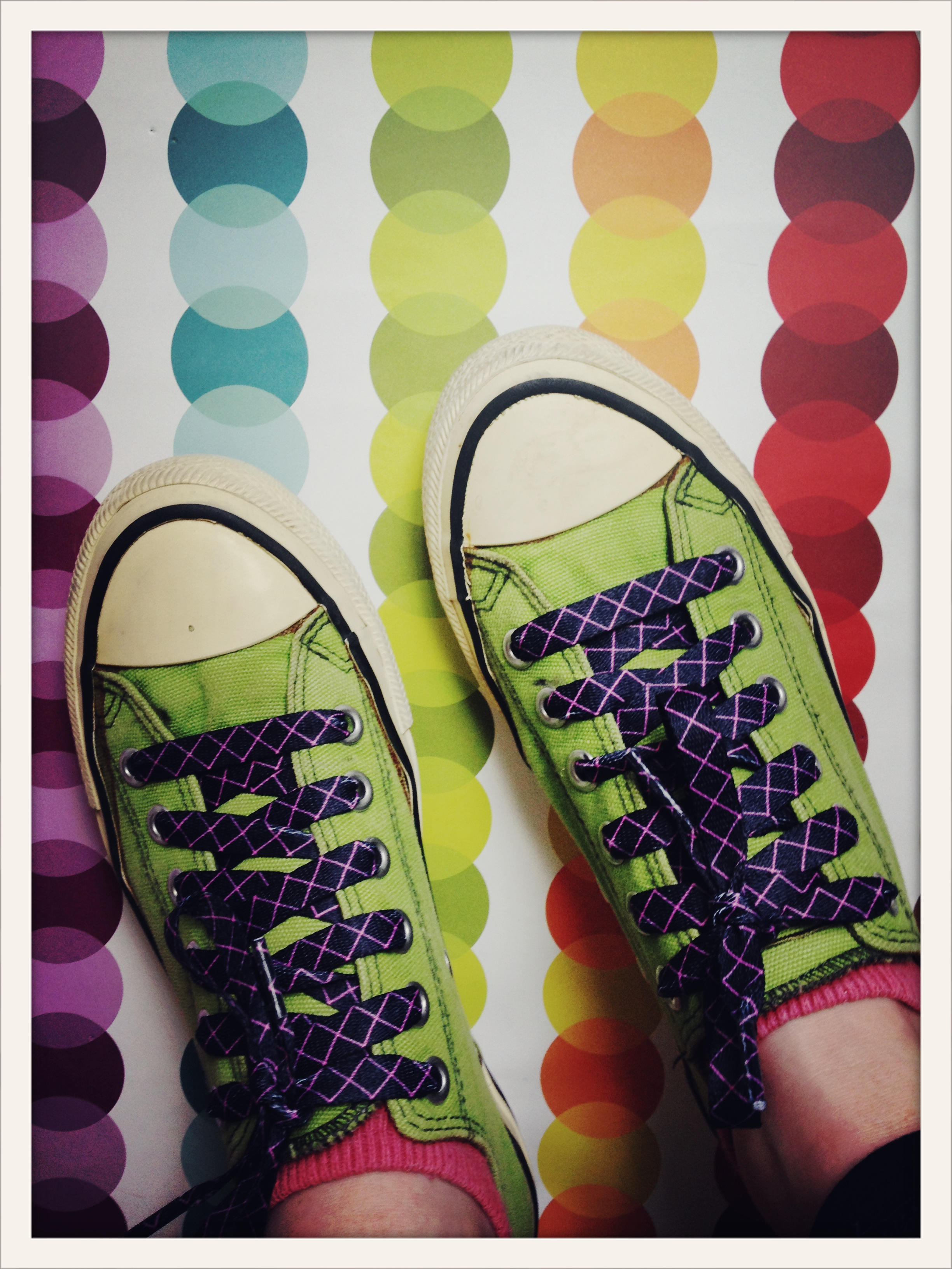 bright green sneakers on dot chains