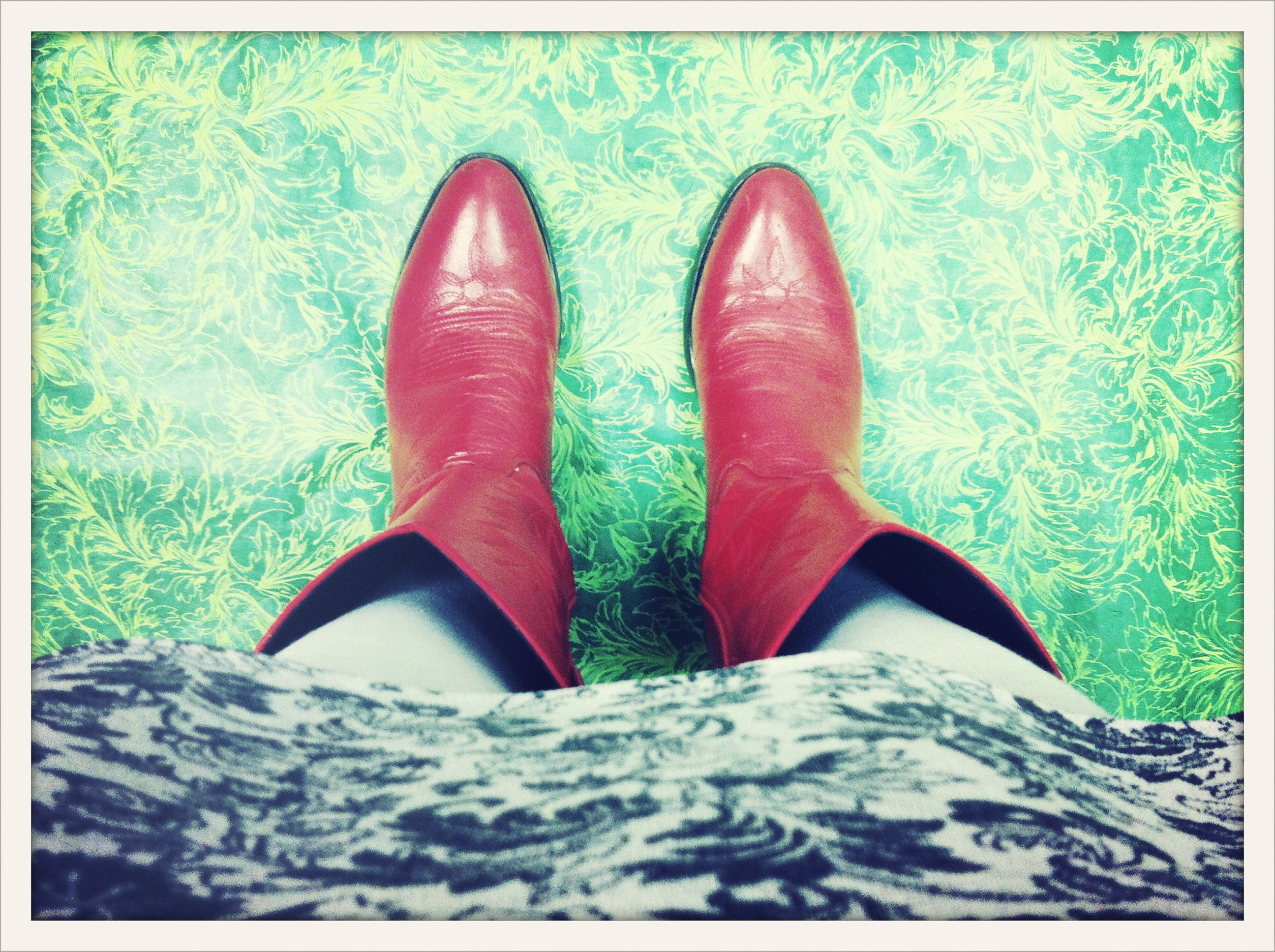 Tennessee red boots on green holly