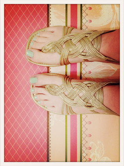 gold sandals on coral pink