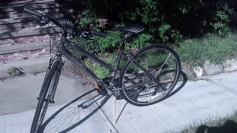Grey bike on sidewalk