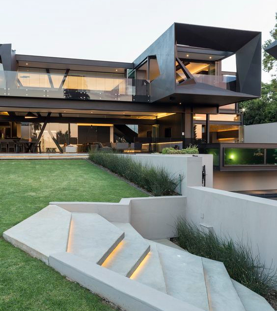 Landscaped lawn with concrete steps and