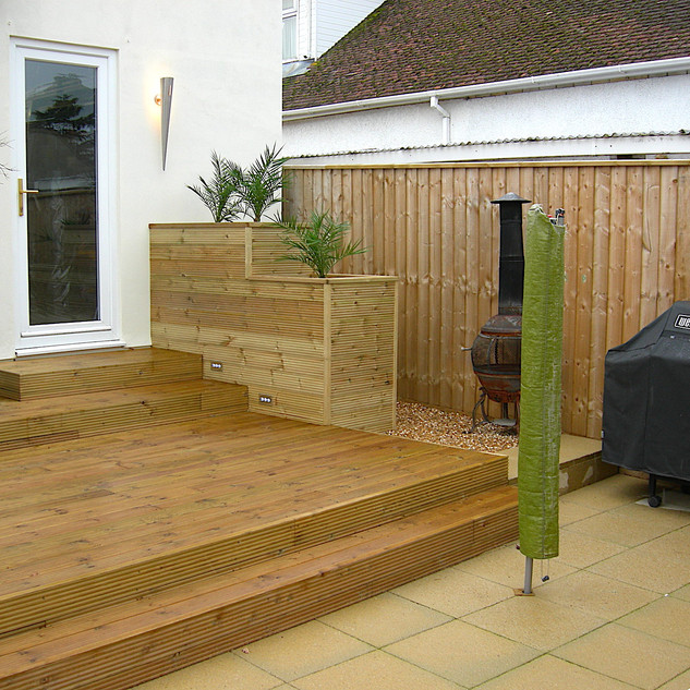 Split level timber decking deck with planter