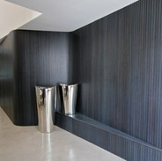 Hallway using different wall coverings.j