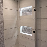 bathroom.shower.tiling.double.niche.jpg