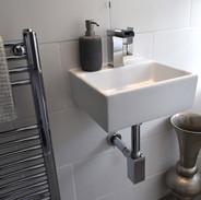 Hand basin with waterfall tap.JPG