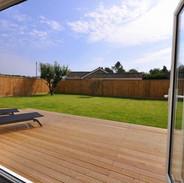 Bi-fold doors onto timber deck and lawn area