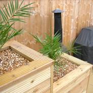 Timber decking planter