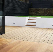 Wood effect composite decking with raised lawn
