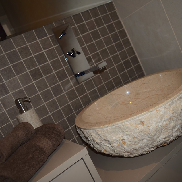 Natural stone counter top sink with wall