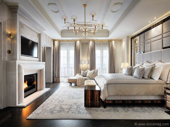 Luxury bedroom with fire place and featu