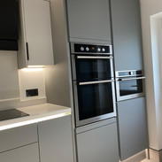 Handleless kitchen with extra-tall appliance towers.