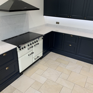 Navy shaker with quartz worktops and oak carcusses