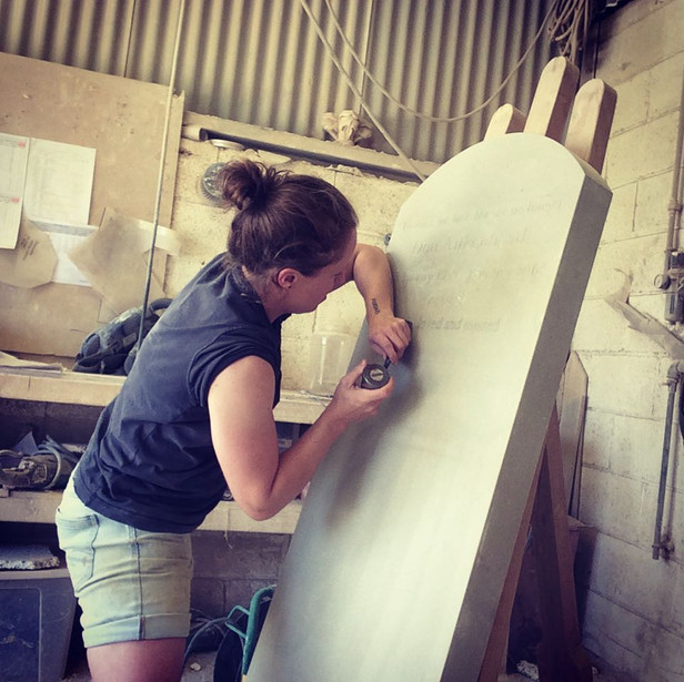 KATE WORKING ON A YORK STONE HEADSTONE