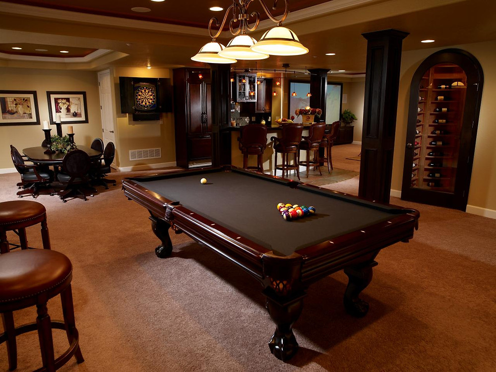 Finished basement with billiard table, bar & wine cooler