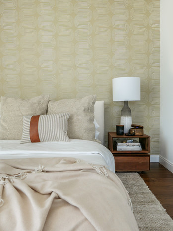 upholsetered-bed-teak-nightstands-swirly-wallpaper-guest-bedroom.jpg