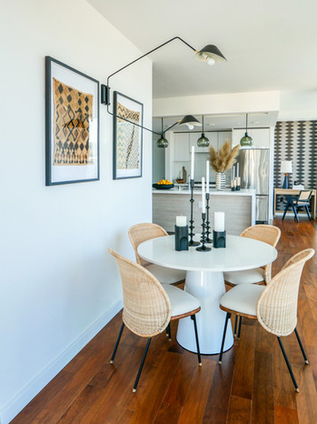dining-pedestal-table-cane-chairs-african-wall-art.jpg