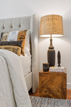 upholstered-king-bed-teak-wood-nightstands-black-cetamic-lamps.jpg
