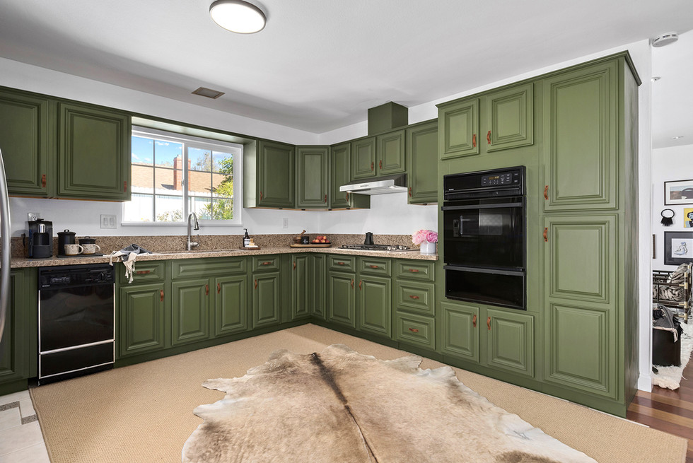 green-kitchen-cabinets-leather-pulls-cowhide-rug.jpg