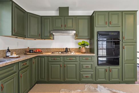 green-kitchen-cabinets-leather-kitchen-handles.jpg