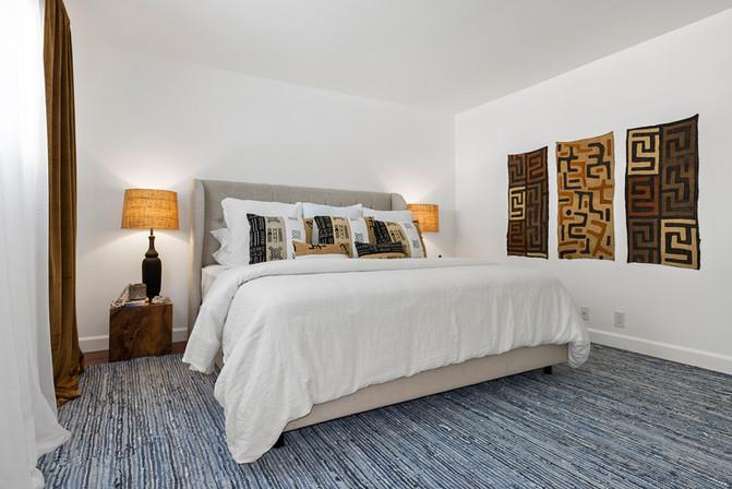 master-bedroom-tufted-natural-linen-bed-teak-nightstands-velvet-drapes.jpg