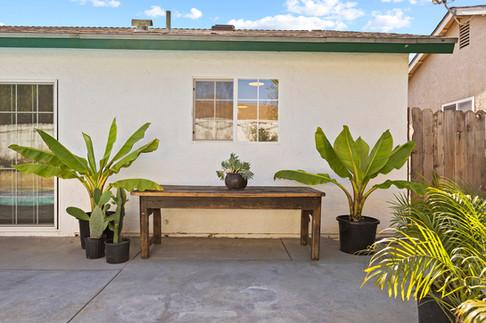 outdoor-farm-table-banana-trees.jpg