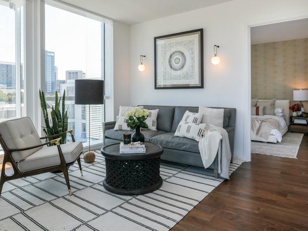 gray-leather-sofa-mcm-armchair-african-coffee-table-moroccan-rug-living-room.jpg