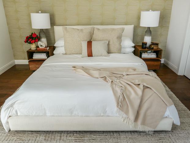 guest-bedroom-teak-nightstands-ceramic-ombe-lamp-upholstered-white-bed.jpg