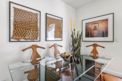 glass-table-top-dining-table-Kuba-cloth-wall-art-iconic-vintage-chairs.jpg