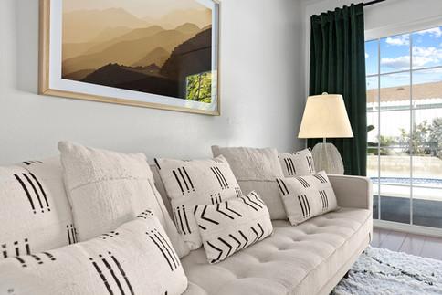 white-tufted-sofa-mud-cloth-pillows-green-velvet-drapes.jpg