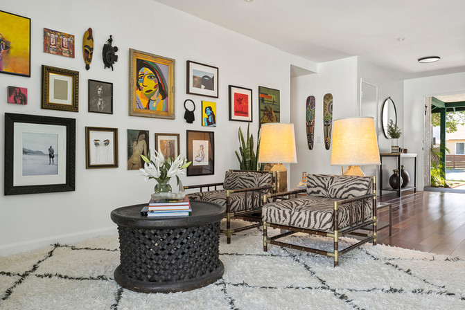 gallery-art-wall-zebra-pattern-upholstered-bamboo-chairs-african-coffee-table-moroccan-rug.jpg