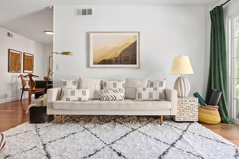 living-room-tufted-white-sofa-mud-cloth-pillows-moroccan-rug.jpg