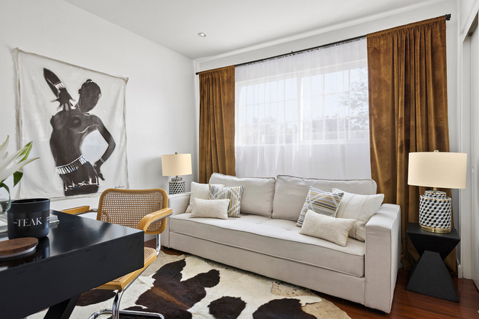 office-sleeper-sofa-velvet-drapes-large-painting.jpg