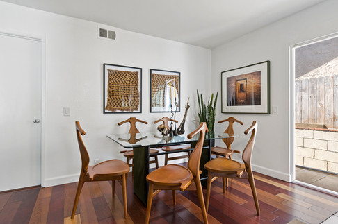 wood_floor_dining_table_cool_chairs.jpg