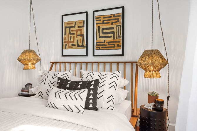bedroom_hanging_lamps_african_pillows.jpg