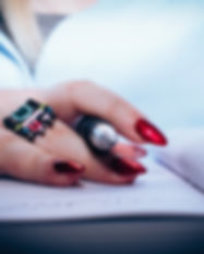 Canva - Person With Red Nail Polish Hold