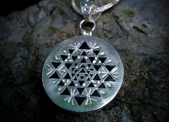 Pendant with silver obsidian stone and openwork mantra behind