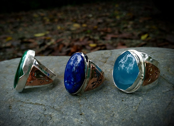 Rings with copper details on the sides.
