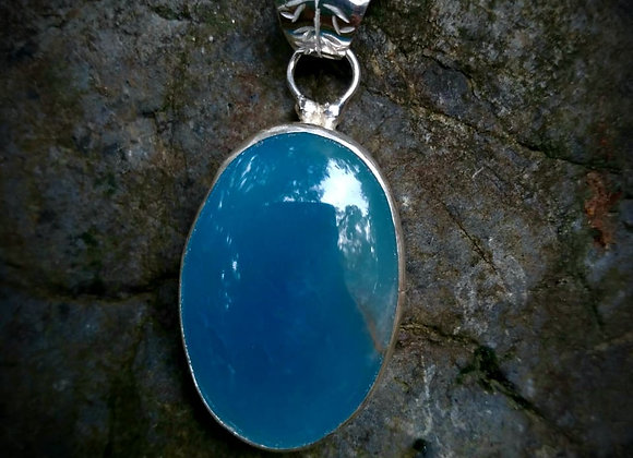 Pendant with sky onyx stone and chiseled flower from behind