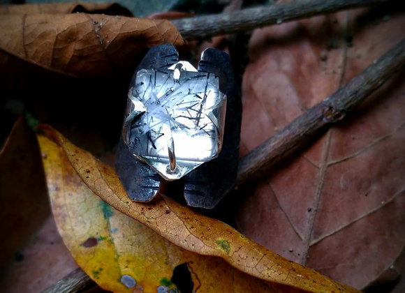 Ring with quartz stone with rutile and aged silver.